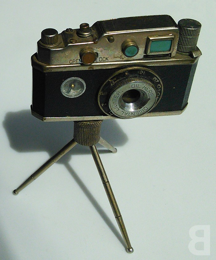 disguise your foibles - camera lighter compass